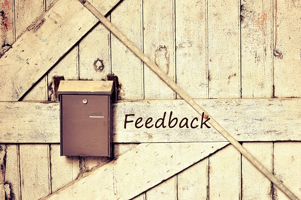 feedback box hanging at a wooden wall